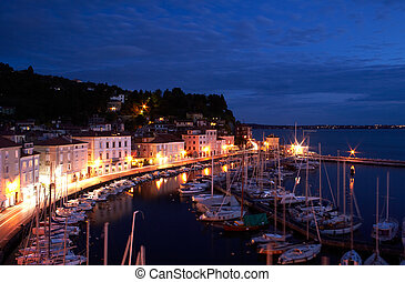 View of boats at sunset in the Piran harbor, Slovenia
