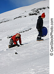 Children playng on snow in Etna Volcano