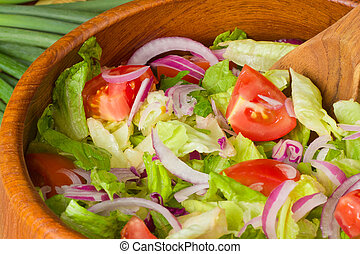 Tossed Salad - Fresh tossed salad in wooden bowl