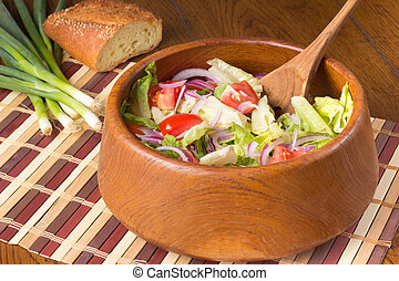 Tossed Salad - A tossed salad in a wooden bowl