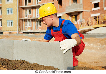 builder installing road concrete kerb - Builder worker using...