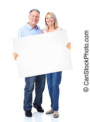 Senior happy couple with placard. Over white background.