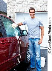 Happy man washing the car.