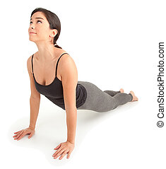 Young Woman Exercising - A young woman is exercising