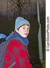 portrait of young teenage boy in the night