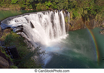 Shifen waterfall is located at Pingxi township in Taipei,...