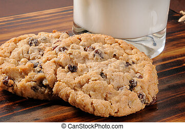 Oatmeal raisin cookies - Two oatmeal raisin cookies with a...