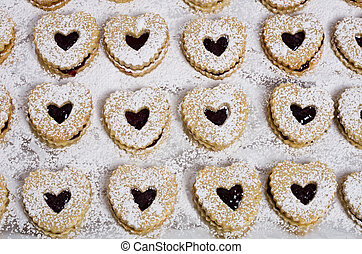 Heart shaped cookies with strawberry jam - A tray of heart...