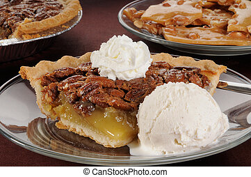 Pecan pie with ice cream - A slice of pecan pie ala mode, a...