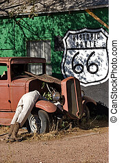 Famous road 66 - Antique automobile and dummies in tourist...