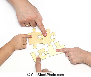 hand with puzzle - Four hands with puzzle isolated on white...