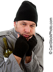 cold homeless tramp with empty bottle over white background