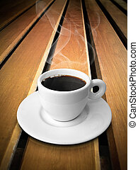 White ceramic of coffee on wood