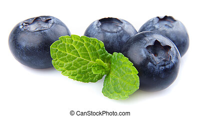 Blueberries and mint - Blueberries with leaf on white...