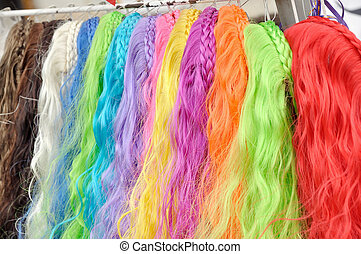 synthetic wigs in different colors for the carnival