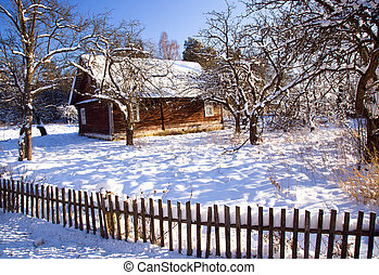 house in the winter - The old wooden house in a winter...