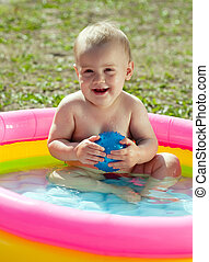 Happy baby swimming  in   pool