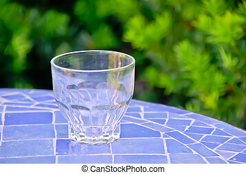 Empty drinking glass - Drinking glass on a mosaic table in...