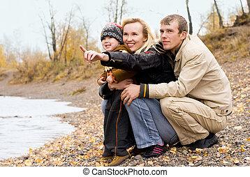 happy family near the lake