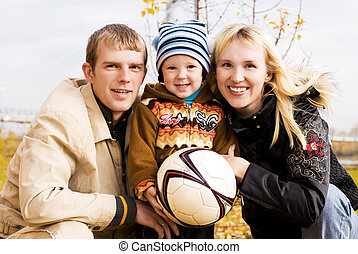 happy family with a football ball outdoor - happy smiling...