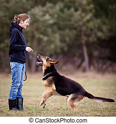 Master and her obedient dog - Master and her obedient German...