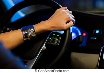 young woman driving her modern car - Driving a car at night...