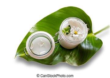Skin cream and beauty flower - Jar of moisturizing facial...