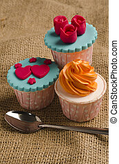 cup cakes - Colorfull cup cake with spoon on canvas mat