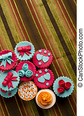 cup cakes - Colorfull cup cakes isolated on cotton...