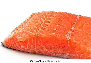 Cut salmon fillet surrounded by white background