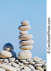 Piece Together - Balancing white pebbles each other on the...