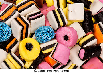 Different all sorts sweets in a pile with different shapes,...