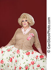 Drag Queen - Tall, smiling drag queen with floral outfit