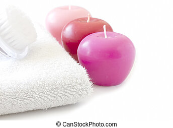 White towel with pink candles and brush spa concept
