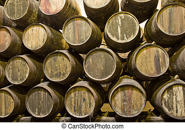cellar with wine barrels - rows of wooden barrels with wine...