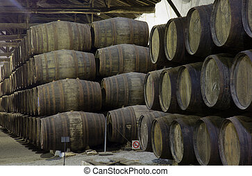 cellar with wine barrels - wine wooden barrels stucked in...