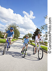 Young Family Parents and Boy Son Cycling - A young family of...