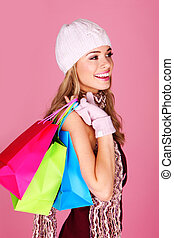 Smiling Woman Out Shopping. Pretty woman with beautiful...