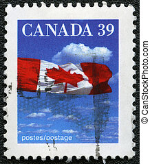 CANADA - 1990: A stamp printed in Canada shows image of the Canadian flag, series, 1990