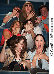 Frightened People in a Theater - Group of seven scared...