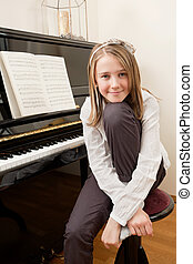 Young girl and her piano - Photo of a young happy girl...