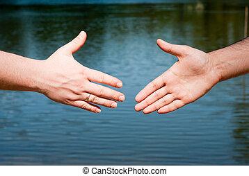 handshake - intention to handshake against the water