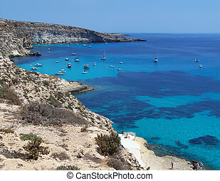 Boats on the island of rabbits- Lampedusa, Sicily - This is...