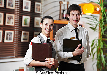 Waitress girl and waiter man in restaurant - Waitress girl...