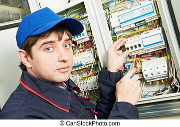 Electrician at work - One electrician working on a...