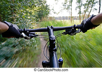 Riding mountain bike - Bicycle rider on moutain bike, motion...