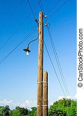 Electrical pylon over blue sky - Electrical wooden pylon,...