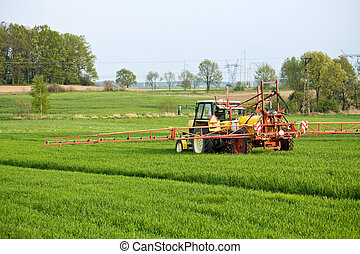 Tractor spraying a field on farm