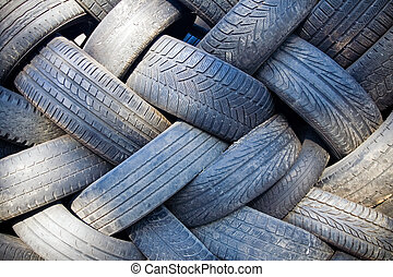 Tire recycling landfill - Tire recycling background, heap of...
