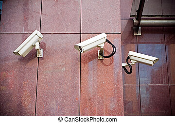 Security cameras on office building - Office building with...